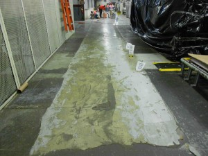With older concrete, installers will degrease floors to ensure adhesion of the coating system